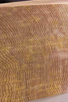 A close-up of the cedar after a similar pass shows slight cutter marks...