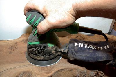 The Hitachi random orbit sander in use