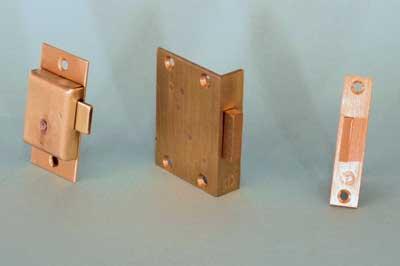 Straight cupboard lock - left - cut cupboard lock - centre - mortise cupboard lock - right