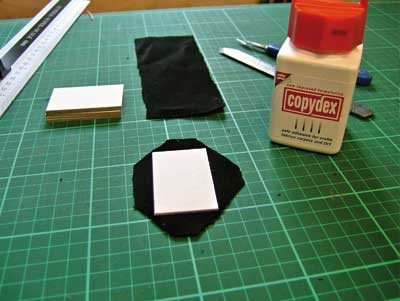 Gluing velvet to hard card for each compartment