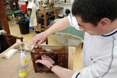 A student polishing a finished piece