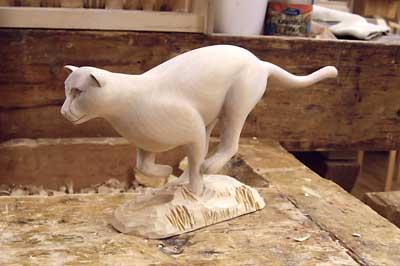Cheetah sculpture in birch, 280 x 130 x 45mm