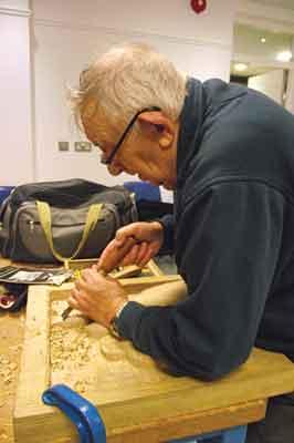 John Stevenson at work on his carving