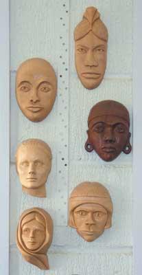 Various wall masks decorating my workshop wall