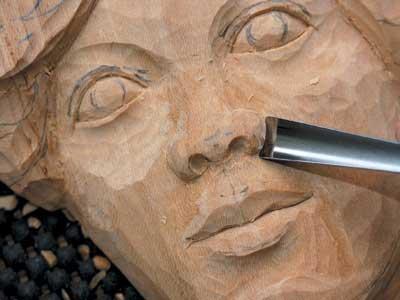 Cut the wings of the nose with a No.8 7mm or a No.7 7mm gouge