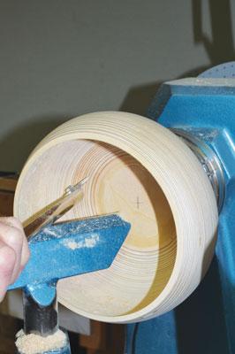 The final shape of the inside is established using a teardrop scraper in shear-scraping mode